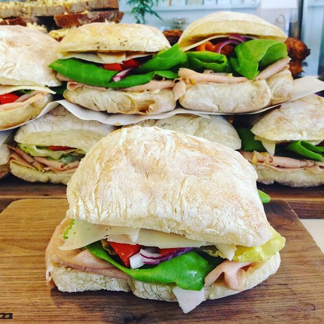 8/6/17 #milkfarmlunch MORTADELLA: red onions, Holey Cow cheese, Classic aioli, butter leaf lettuce, Dijon, & sweet and hot pickled peppers on ciabatta • VEGGIE: cucumber, radish top pesto, shaved radishes, & herb butter on ficelle •FRENCH HAM: herb butter, double cream Brie, & cracked black pepper on ficelle • SIGNATURE GRILLED CHEESE