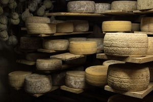 Parish-Hill-Cheese-Cave-aging-wheels-of-cheese