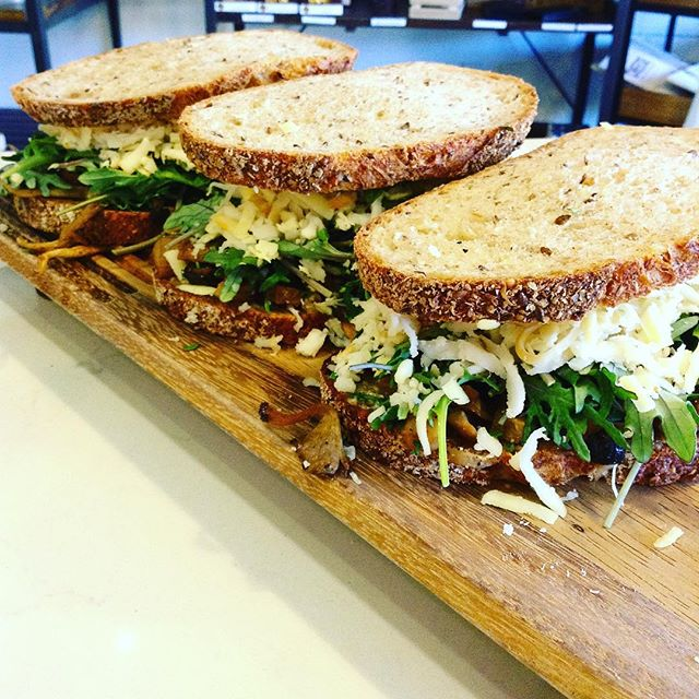 12/29/2017 #milkfarmlunch 1) FRENCH HAM: herbed butter, double creme Brie, & cracked black pepper on ficelle 2) CRISPY JAMON SERRANO: campo de montalban, thyme quince jam, Marcona almonds, greens, & EVOO on ficelle 3) MUSHROOM MELT: mixed roasted mushrooms, black garlic aioli, greens, smoked mozzarella, & Mahon on multigrain 4) ROASTED BEETS: creamy goat cheese, roasted pistachios, herbs, Beurremont butter, & greens on multigrain 5) MUFFALETTA: mortadella, salami rosa, fresh mozzarella, classic aioli, & greens on ciabatta 6) MILKFARM GRILLED CHEESE
